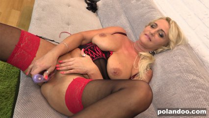 Mature blonde with toy